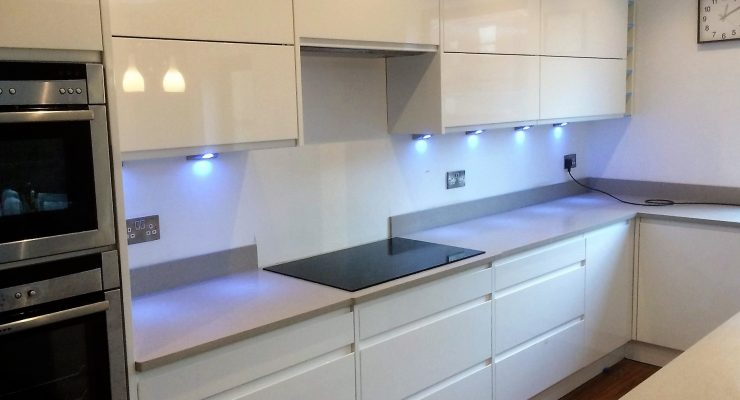 Mirostone worksurface with White Gloss handleless doors