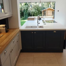 LG Hi Macs Apline white solid surface top with raised solid oak bar area